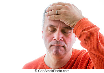 Forgetful man holding his hand to his forehead with a...