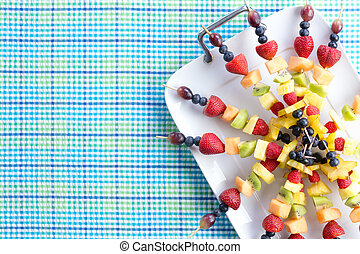 Fresh healthy tropical fruit shish kebabs