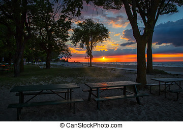 WI Sunrise - Sunrise on picnic tables at Neshotah Park in...
