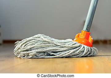 wet mop on wooden floor - cleaning wooden floor with orange...