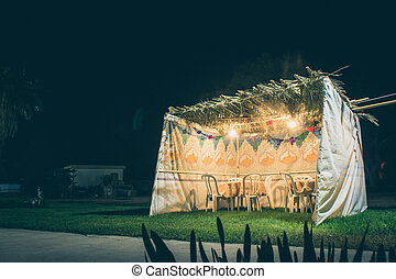 Sukkah - symbolic temporary hut for celebration of Jewish...