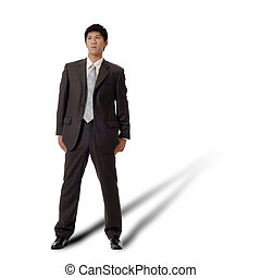 Lonely business man standing, full length portrait isolated...