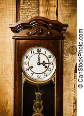 old clock on a wooden wall