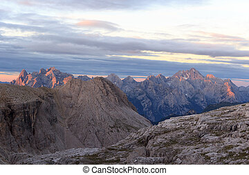 Sexten Dolomites mountains panorama with Alpenglow at...