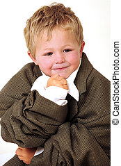 Blond young Boy in oversized business clothes in thinking...