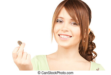 lovely teenage girl with coin - picture of lovely teenage...