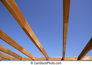blue sky wooden golden awning beams in summer beach