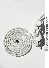 spiral white sea nautical rope on boat mooring - spiral...