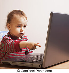 beautiful baby girl working with laptop (Humorous picture)
