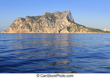 Ifach Penon mountain in Calpe from blue sea in Alicante...