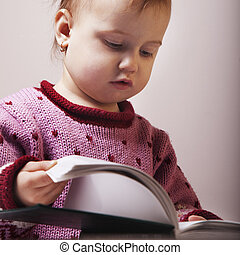baby is watching a book (Science, education, knowledge,...