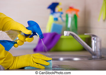 Kitchen cleaning concept - Close up of human hand in...