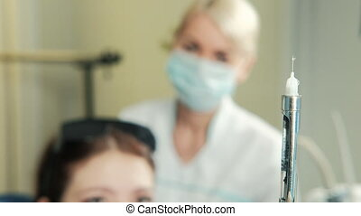 Dentist releases air from syringe to make patient injection....