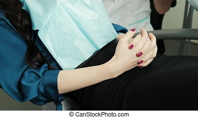 Patient woman sitting worried before treatment in a medical...