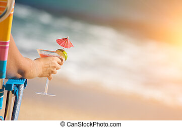 Woman on Beach with Tropical Drink - Woman Relaxing on Beach...
