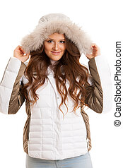 Beautiful young woman in winter jacket isolated over white