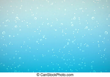 fresh fizzy water in the glass with bubbles background