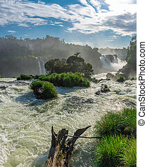 Close view of one of the Cataratas water falls under blue...