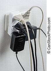 Overloaded - Multiple electrical plugs in wall outlet