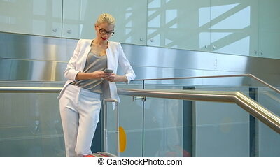 Slow shooting of woman chatting on phone in departure hall.