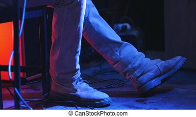 Guitarist at concert in club - view of legs, close up,...