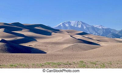 Great Sand Dunes and snowy mountains. - Great Sand Dunes...