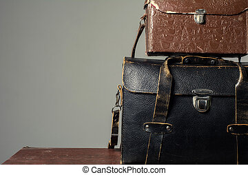 Leather suitcases old photographer. Background Traveller...