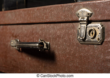 Close-up of a suitcase. Iron Castle vintage bag. Place of...