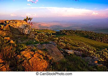 drakensberg landscape - view over the escarpment at dusk in...
