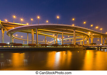Highway interchange river front with twilight sky background