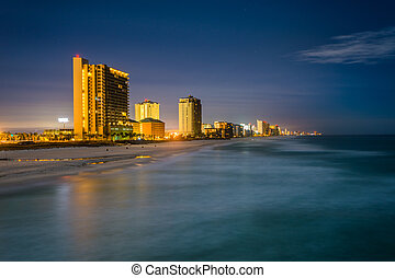Highrises along the Gulf of Mexico at night, in Panama City Beach, Florida.