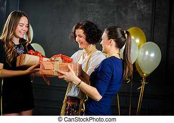 The girl receives congratulations and gifts from...