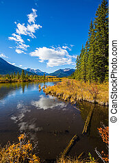 The shallow lake Vermilion among mountains and the woods....
