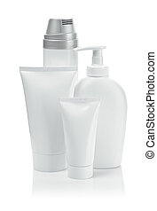 white cosmetical tubes and spray bottles