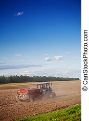 tractor on the cultivated field