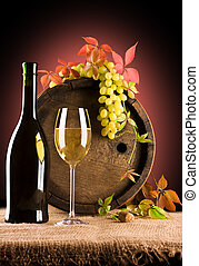 composition of white wine and grape and foliage of grape