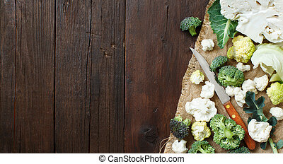 Fresh raw cauliflower and broccoli on an old wooden table...