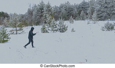 Man Cross-Country Skiing Alone in Nature - Man Cross-Country...