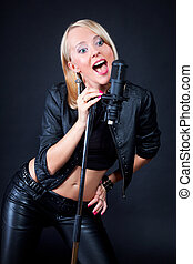 beautiful blonde with a microphone
