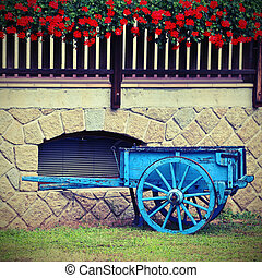wooden cart with the geranium - blue old wooden cart with...