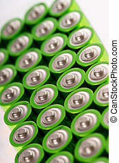 Batteries - Many batteries in front of a light background