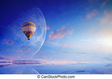 Hot air balloon in blue sky with rising full moon - Amazing...