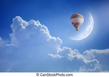 Colorful hot air balloon rise up into blue sky above white...
