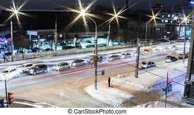 City timelaps - Timelaps. Dense traffic in night winter city