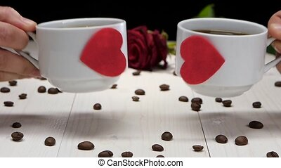 Two cups of coffee for romantic lovers. Slow motion - Two...