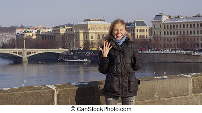 Engagement ring. Woman on the charles bridge showing ring after marriage proposal. Excited cute girl. RED EPIC. slow motiom