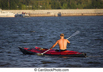 man in the boat with paddles. water sport