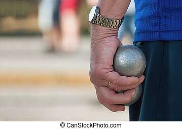 Hand of holding petanque ball - Senior playing petanque,fun...