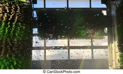 Automatic car wash, view from inside a vehicle