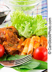 Dish of beef stew with pasta penne, cherry tomatoes and...